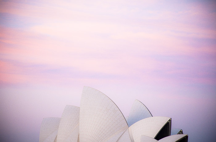 photograph of the sydney opera house at sunset