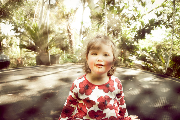 Toddler on trampoline photograph