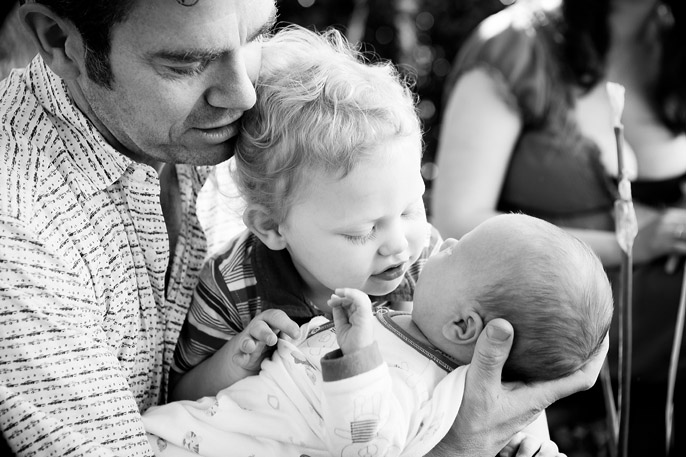 toddler kissing baby photograph