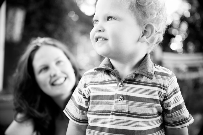 image of toddler smiling with his mother